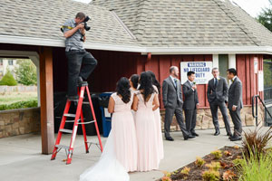 photographer on a ladder