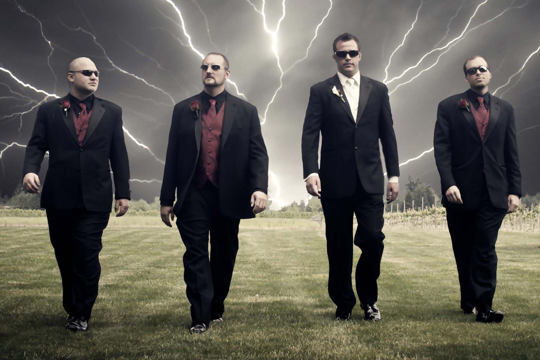 groom walking with groomsmen with lightning